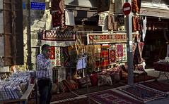 Businessman (rknecht) Tags: shop israel jaffa tapis carpet colors couleurs vendeur saler city ville urban streetphoto street rue photoderue holidays vacances travel voyage canon650d canonefs24mm