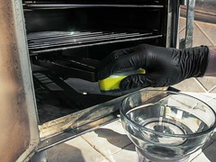 Cleaning the electric smoker oven with sponge and black glove racks in door ajar on the patio after barbecuing and smoking meats (yourbestdigs) Tags: woodchips tray smoking bisquettes chicken meat beef pork loin thigh leg bone sliced pulled boneless ribs smoker smoke smoked loader display digital butt dripping grease dry rub marinated marinate marinade char broil broiler broiled black glove cleaning outside patio bbq chip burger breast barbecue hickory charcoal ash hardwood chippings chipping cook cooking cooked chef oven bake baked fried moist skinless cleaner sponge water