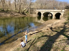 The twins playing on Catoctin Creek near the Potomac today (dionhinchcliffe) Tags: moblog iphonepics