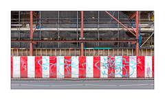 Construction Site, East London, England. (Joseph O'Malley64) Tags: buildingsite hordings walkway steelbeams rsjs reinforcedsteeljoists framework supports facade originalvictorianfacade safetycurtains safetynetting eastlondon eastend london england uk britain british greatbritain constructionsite redwhite pattern alternatingcolours graffiti tags throwies scaffoldplanks knuckles scaffold scaffoldi scaffoldpoles granitekerbing tarmac street zebracrossingproximitymarkers urban urbanlandscape fujix fujix100t accuracyprecision colour vivid vividcolour