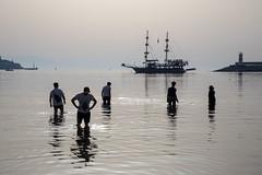 Evening paddle (mfatic) Tags: otherkeywords waves ship silhouette calm swimmers paddle water reflection ripple environment kuşadası asiaminor harbour sea aydın turkey tr