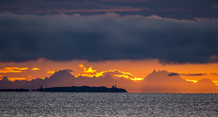 Trial Island Sunrise (Paul Rioux) Tags: sunrise morning daybreak dawn clouds mountains weather trialisland victoria bc outdoors sea ocean water scenic bold orange yellow lighthouse silhouette