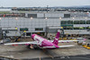 wow airlines flight 161 from reykjavik arrives at gate 4 (pbo31) Tags: bayarea california nikon d810 color rain april spring 2018 boury pbo31 sanfranciscointernational sfo sanmateocounty aviation airport airline travel millbrae plane gate wow purple airbus