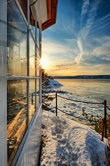 Gazebo with a fjord view (Vest der ute) Tags: norway akershus sea fjord seascape landscape ice water winter winterscape sky clouds snow fence window reflections gazebo sunstar fav25 fav200