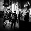 He who dares (Kieron Ellis) Tags: man men hat running street candid blackandwhite blackwhite monochrome shadow light