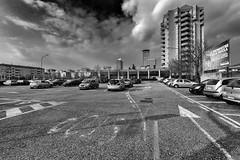 Parking (drugodragodiego) Tags: brescia lombardia italy city cities parcheggio cars skyscraper urbanlandscape street wideangle blackandwhite blackwhite bw biancoenero pentax pentaxk1 k1 pentaxdfa1530mmf28 hdpentaxdfa1530mmf28edsdmwr