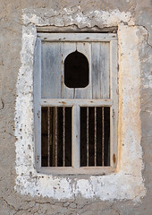 Wooden carved window of an abandoned house, Dhofar Governorate, Mirbat, Oman (Eric Lafforgue) Tags: abandoned arabia arabianpeninsula arabic arabicarchitecture arabicstyle architecture buildingexterior carved carvedwindow carvingcraftproduct colorimage day decrepit dhofar dhufar exteriorview facade ghosttown gulfcountries habitation history house houseexterior mirbat moscha nopeople old oldhouse oman oman18187 outdoors sultanate thepast traveldestination traveldestinations vertical weathered window woodenwindow dhofargovernorate om