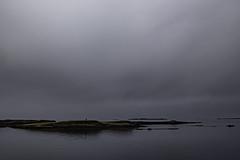Navigation Beacon (jessicalowell20) Tags: stykkisholmur adventure black calm clouds coast coastal coastalnavigation dramticsky europe gold gray harbor horizon iceland islands may northatlanticocean orange silver spring summer travel westiceland