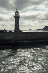 East Pier lighthouse, Whitby (Keartona) Tags: whitby harbour entrance water sunlight lighthouse morning sea coast northyorkshire history light england tower sky clouds