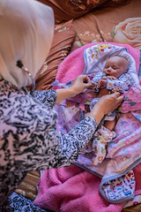 New Born Baby getting care from Midwife, Indonesia (ReinierVanOorsouw) Tags: indonesia indonesie java batu sonya7 sonya7r a7r2 a7r travel asia asya travelling reinierishere reiniervanoorsouw maternity babies baby mother mothers