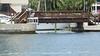 A Bridge to Cross (soniaadammurray - On & Off) Tags: digitalphotography artchallenge bridge fences water sea seawall boat boating stairs walkway lights trees flowers buildingscar hff