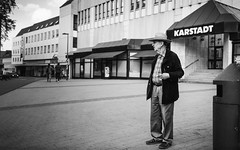 Is this the real life? Is this just fantasy? (Zesk MF) Tags: bw black white street candid life living elderly people hat wondering modern times zesk strase mono man standing verwundert reality