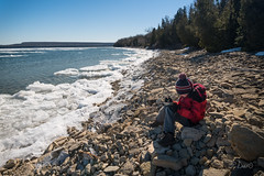 Boy examines rocks along shore of lake in Ontario winter (blurMEDIA Stock) Tags: brucepeninsula canada earth georgianbay ontario child childhood climate climatechange cold conservation environment exploring fragile freezing frozen globalwarming ice icy lake lakeshore landscape learning melt melting outdoor phasechange planet preservation shoreline solitary solitude spring springthaw stewardship thaw warming water wilderness winter winterjacket
