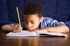 Stock Images (perfectionistreviews) Tags: 1 africanamerican arithmetic assignment black blankexpression book boy child concentration couch education focus headandshoulders home homework horizontal house indoors inside kid lifestyle livingroom male notebook one pencil pensive person school schoolwork serious sitting sofa workbook writing young color photograph brunette reading childhood children paper portrait