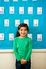 Stock Images (perfectionistreviews) Tags: 1 adding addition arithmetic brunette cheerful child class classroom education elementaryschool female flashcards girl grinning happiness happy hispanic indoors inside kid learning math mathematics one person smile smiling standing student waistup young latino color photograph vertical childhood children cute lookingatviewer portrait