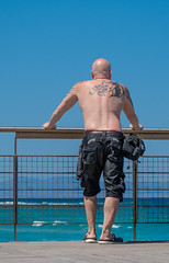 Protaras, Cyprus, 2018. (CWhatPhotos) Tags: cwhatphotos 2018 april digital camera pictures picture image images photo photos foto fotos that have which contain olympus seafront golden coast beach blue sky skies holiday water sea deep color colour 43 micro four thirds penf protaras cyprus easternmale waters fence man men with tattoos tattoo tattooed tatts tat ink inked back