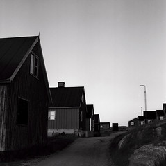 Kuummiit street (Úlfur Björnsson) Tags: b black white bw greenland trip traveling ilford dusk sunset mamiya kuummiit medium format film c220 80mm f28 sekor hp5 plus iso 400 houses house town