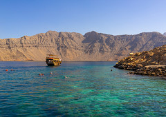 Tourists snorkelling in telegraph island, Musandam Governorate, Khasab, Oman (Eric Lafforgue) Tags: arabia arabianpeninsula beautyinnature cliff colorimage day elphinstoneinlet exclave fjord gulfcountries horizontal idyllic jazīratalmaqlab khasab khasabbay khorashsham landscape majestic mountain mountainrange musandam musandampeninsula nature nauticalvessel nopeople nonurbanscene oman oman18458 outdoors photography rock rockformation rockymountains scenics sea snorkelling telegraphisland tranquilscene tranquility transportation water musandamgovernorate