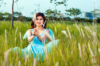 Playing with grass flower on field