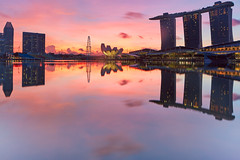 Reflections from the past (Shutter wide shut) Tags: canoneos5dmarkiii canontse24mmf35lii longexposure marinabay marinabaysands singapore singaporeflyer singhraylbwarmingpolarizer singhrayreversendgradfilter sunrise reflections