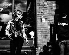 Observing logic (Kieron Ellis) Tags: woman man window reflection cigarette jacket wall street candid tattoo blackandwhite blackwhite monochrome