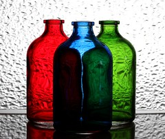 3 Bottles (Karen_Chappell) Tags: three 3 bottle bottles glass blue green red rgb stilllife white refraction
