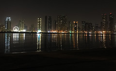 Sharjah Skyline (Irina.yaNeya) Tags: sharjah uae emirates city urban architecture skyline skyscraper night sea ocean water waves coast shore beach sky iphone reflection building light eau cielo ciudad arquitectura noche mar agua olas costa playa reflejo edificio luz الامارات الشارقة مدينة فنمعماري برج ليل بحر ماء شاطئ أمواج سماء بناء ضوء шарджа оаэ эмираты город архитектура здание море вода отражение волны берег небо ночь свет