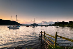 Ullswater Yacht Club, Cumbria, England (vincocamm) Tags: cumbria ullswater lake yacht fence flower orange blue yellow nikon d5500