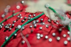 pincushion (jlodder) Tags: pincushion pins fabric thread bokeh directflash pinheads flickrfriday flare red hexagonal