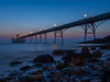 The Soul is in the Stones (RS400) Tags: sea water sky clouds blue sun set wow amazing cool travel somerset north olympus low down stones blur long exposure lights clevedon pier night time photography landscape