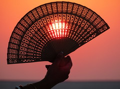 Sun and shades (Onlyshilpi) Tags: bhuj rannofkutch gujarat silhouette fan hand sunset dusk