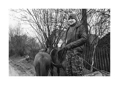 Teamster (Jan Dobrovsky) Tags: carpathians leicaq smile people reallife milk teamster countryside road monochrome portrait outdoor village bottle blackandwhite ukraine mud horse countrylife document