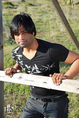 Anjani (Levi Smith Photography) Tags: tshirt black hair man south asian indian guy handsome cute windy clothing grass fence pose fashion mens mans portrait hot