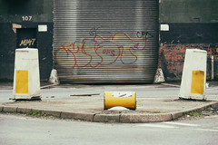 (Delay Tactics) Tags: 107 sheffield bollards road intersection junction drum yellow shutter mist kerb graffiti explore