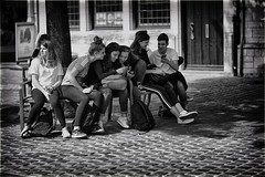 The i-Generation (Fouquier ॐ) Tags: kids smartphone group girls bench mono monochrome urban street streetphotography blackandwhite bw antwerp belgium