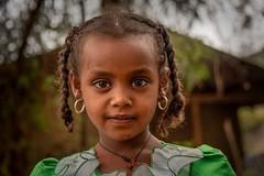 Lalibela Girl (Rod Waddington) Tags: africa african afrique afrika äthiopien ethiopia ethiopian ethnic etiopia ethnicity ethiopie etiopian tigray lalibela girl culture cultural child streetphotography trees house portrait people outdoor