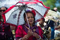 Lady in Red (michael.mu) Tags: leica m240 noctilux leicanoctiluxm50mmf095asph neworleans nola parade portrait supersunday