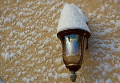 Snow-Plastered Wall with Lantern Reflecting Light at Sunrise (Ginger H Robinson) Tags: snow plaster wall lantern reflection glass light early spring morning rockymountain frontrange colorado macro
