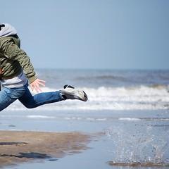 DSC_0023 Springtij?? (marcnico27) Tags: jump shore strand beach northsea noordzee zandvoort man male outdoor sky wet 2018 legs jeans