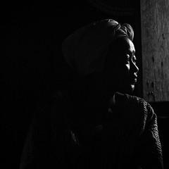 munyenge (khrawlings) Tags: cameroon woman portrait lowkey blackandwhite bw monochrome profile window africa outline shoulder headscarf face munyenge dress church square