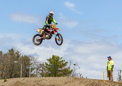 Leaping Into The Blue Sky (John Kocijanski) Tags: motorcycle motocross vehicle sport dirtbike canon70300mmllens canon7d people red