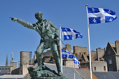 St Malo - statue of Robert Surcouf (philk_56) Tags: stmalo france robert surcuof statue flags rooftop quebec