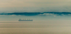 In the Mist (langdon10) Tags: atsea canada canon70d fog quebec ship shoreline stlawrenceriver mist nautical outdoors