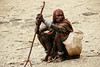 squatter (rick.onorato) Tags: africa ethiopia omo valley tribes tribal hammer woman