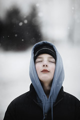 (Rebecca812) Tags: boy child snow hood evergreentrees snowing portrait people cold weather photography hat coat hoodie snowflakes cool eyesclosed canon blue
