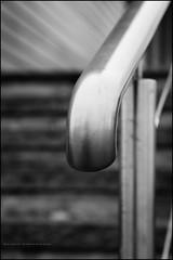 Handrail (G. Postlethwaite esq.) Tags: bw dof derbyshire findern merciamarina uk willington beyondbokeh blackandwhite bokeh closeup depthoffield fullframe handrail monochrome photoborder selectivefocus stainlesssteel