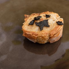 Grilled baguette with black garlic. (annick vanderschelden) Tags: bread baguette french oliveoil grilled blackgarlic garlic pottery plate yellow food cooking cuisine belgium