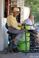 Machete (Nino La Corte) Tags: people elderly street wheel bikeelder vehicle old portrait craft grinderjob machete man