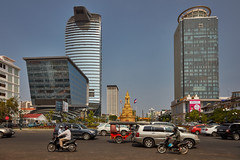 Phnom Penh downtown (Thomas Mülchi) Tags: 2018 cambodia phnompenh persons people architecture downtownstreet modernarchitecture highrise kh