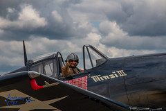 Thumbs up (plane driver) Tags: bealeafb beale california aviation airshow flight fliing pilot aviator portrait f6f hellcat navy wwii fighter propeller plane classic clouds sky minsiiii caf cafsocal canon 70d
